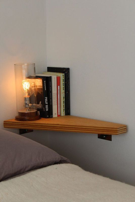 7-install-a-corner-shelf-where-there-is-no-room-for-a-nightstand-29-sneaky-tips-for-small-space-living